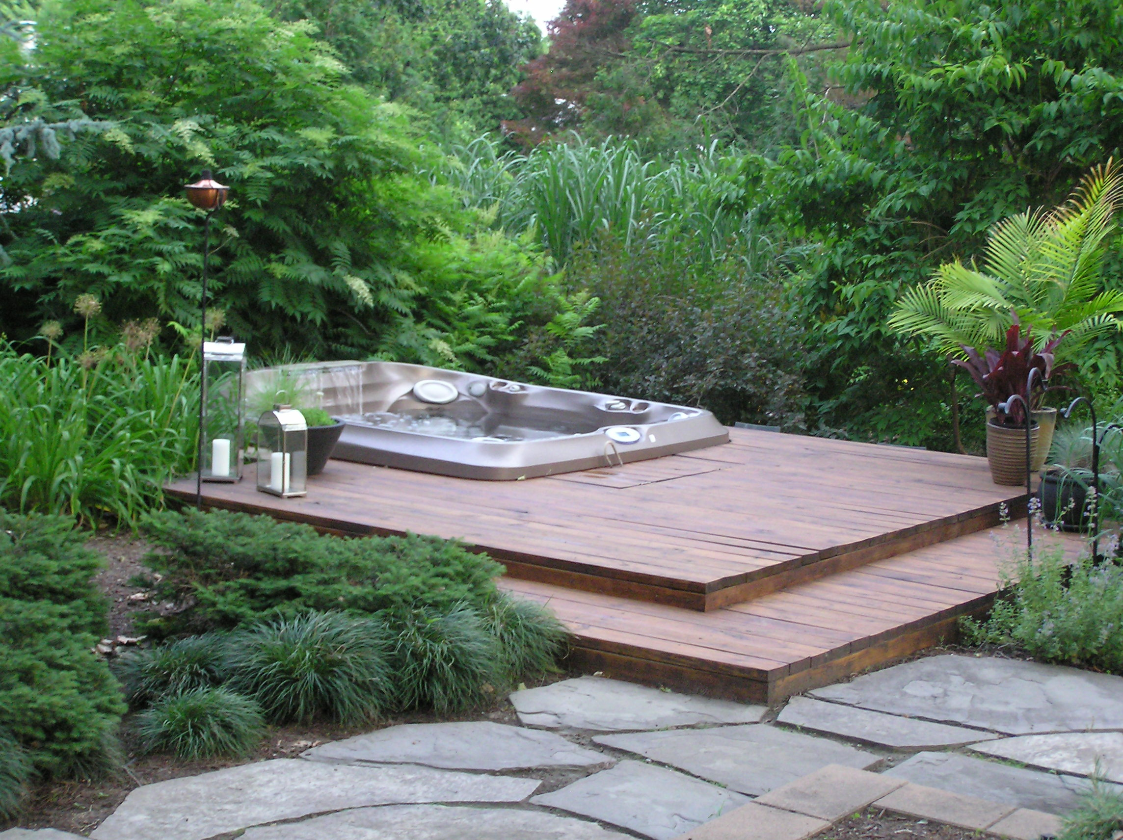 Two Level Hot Tub With Deck On Top Bar Below Garden